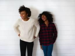 Jokes overlap; Two women laughing at funny joke